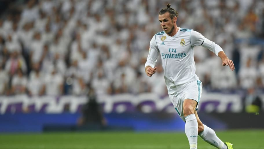 Real Madrid's forward from Wales Gareth Bale controls the ball during the Spanish league football match Real Madrid CF against Real Betis  at the Santiago Bernabeu stadium in Madrid on September 20, 2017. / AFP PHOTO / GABRIEL BOUYS        (Photo credit should read GABRIEL BOUYS/AFP/Getty Images)
