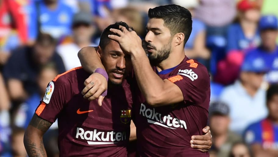 Barcelona's forward from Uruguay Luis Suarez (R) congratulates Barcelona's midfielder from Brazil Paulinho after scoring a goal during the Spanish league football match Getafe CF vs FC Barcelona at the Col. Alfonso Perez stadium in Getafe on September 16, 2017. / AFP PHOTO / PIERRE-PHILIPPE MARCOU        (Photo credit should read PIERRE-PHILIPPE MARCOU/AFP/Getty Images)