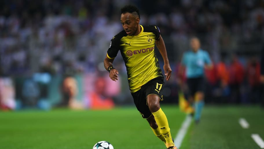 Dortmund's Gabonese forward Pierre-Emerick Aubameyang runs with the ball during the UEFA Champions League Group H football match BVB Borussia Dortmund v Real Madrid in Dortmund, western Germany on September 26, 2017. / AFP PHOTO / Odd ANDERSEN        (Photo credit should read ODD ANDERSEN/AFP/Getty Images)