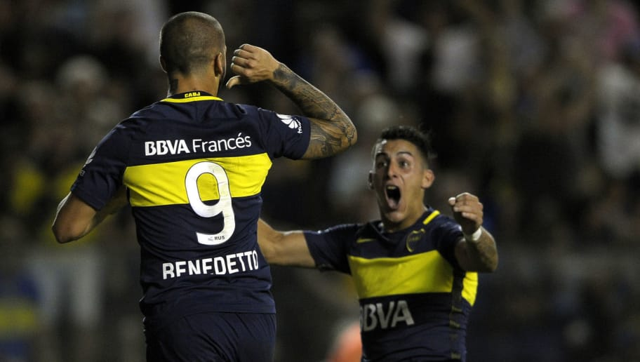 Boca Juniors' forward Dario Benedetto (L) celebrates with his teammate forward Cristian Pavon after scoring a goal against Defensa y Justicia during their Argentina First Division football match at La Bombonera stadium in Buenos Aires, on April 1, 2017. / AFP PHOTO / ALEJANDRO PAGNI        (Photo credit should read ALEJANDRO PAGNI/AFP/Getty Images)