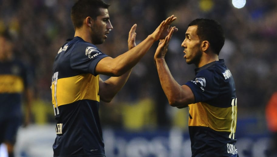 BUENOS AIRES, ARGENTINA - JULY 18:  Jonathan Calleri of Boca Juniors celebrates with teammate Carlos Tevez after scoring the second goal of his team during a match between Boca Juniors and Quilmes as part of 17th round of Torneo Primera Division 2015 at Alberto J Armado Stadium on July 18, 2015 in Buenos Aires, Argentina. (Photo by Amilcar Orfali/LatinContent/ Getty Images)