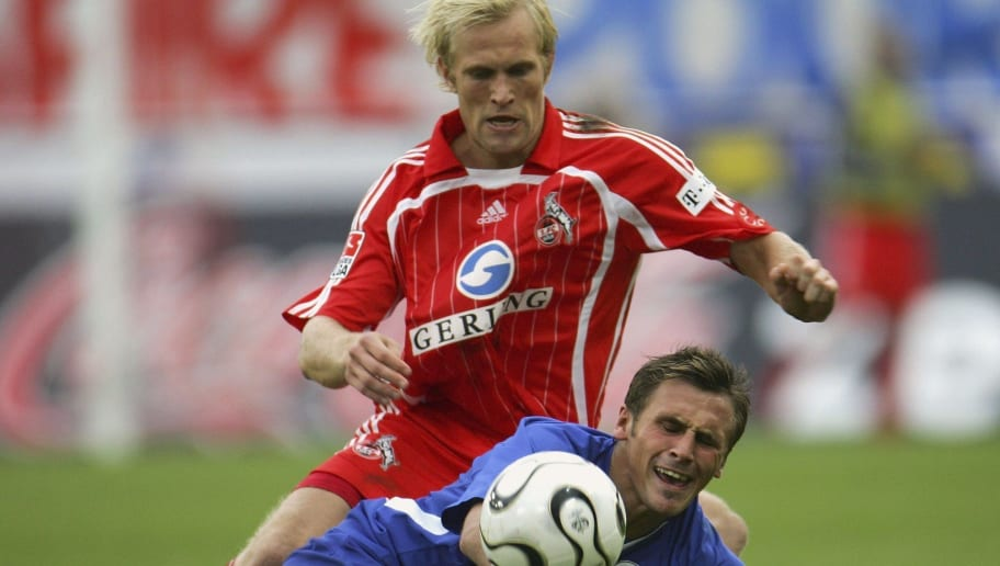COLOGNE, GERMANY - OCTOBER 29:  Pekka Lagerblom of Cologne (L) and Marcel Schied of Rostock battle for the ball during the Second Bundesliga match between 1.FC Cologne and Hansa Rostock at the RheinEnergie stadium on October 29, 2006 in Cologne, Germany.  (Photo by Vladimir Rys/Bongarts/Getty Images)