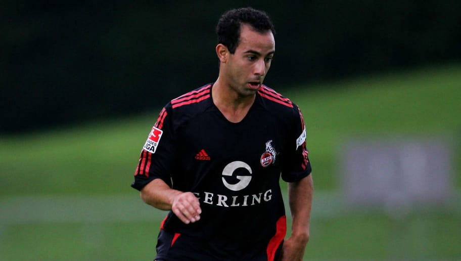 TROISDORF, GERMANY - AUGUST 30:  Salvatore Gambino of Cologne runs with the ball during the friendly match between 1.FC Cologne and Red Bull Salzburg at the Agger Stadium on August 30, 2006 in Troisdorf, Germany.  (Photo by Lars Baron/Bongarts/Getty Images)