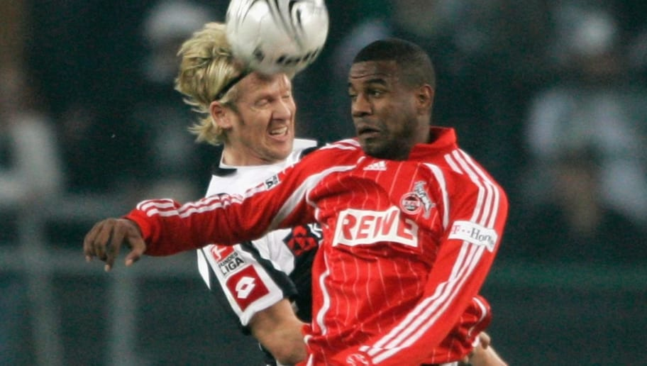 MOENCHENGLADBACH, GERMANY - OCTOBER 22:  (L-R) Sascha Roesler of Moenchengladbach and Antunez Suazo of Cologne go up for a header during the 2nd Bundesliga match between Borussia Moenchengladbach and 1. FC Cologne at the RheinEnergie stadium on October 22, 2007 in Moenchengladbach, Germany.  (Photo by Christof Koepsel/Bongarts/Getty Images)