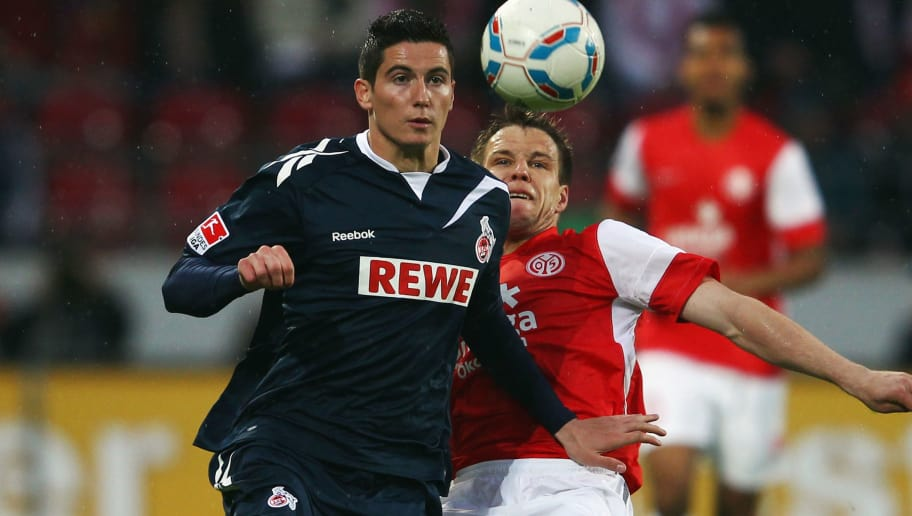 MAINZ, GERMANY - APRIL 10: Odise Roshi (front) of Koeln is challenged by Radoslav Zabavnik of Mainz during the Bundesliga match between between FSV Mainz 05 and 1. FC Koeln at Coface Arena on April 10, 2012 in Mainz, Germany.  (Photo by Alex Grimm/Bongarts/Getty Images)