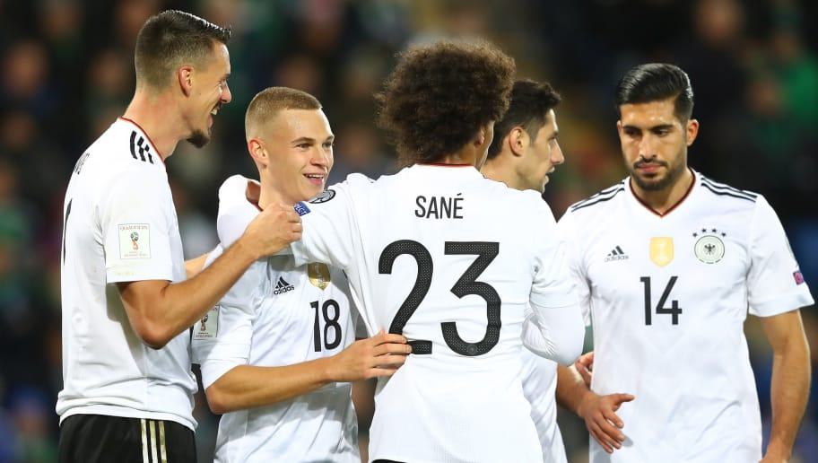 BELFAST, NORTHERN IRELAND - OCTOBER 05:  Joshua Kimmich of Germany celebrates scoring the third goal with Lars Stindl, Sandro Wagner, Leroy Sane  and Emre Can during the FIFA 2018 World Cup Qualifier between Northern Ireland and Germany at Windsor Park on October 5, 2017 in Belfast, Northern Ireland.  (Photo by Alexander Hassenstein/Bongarts/Getty Images)