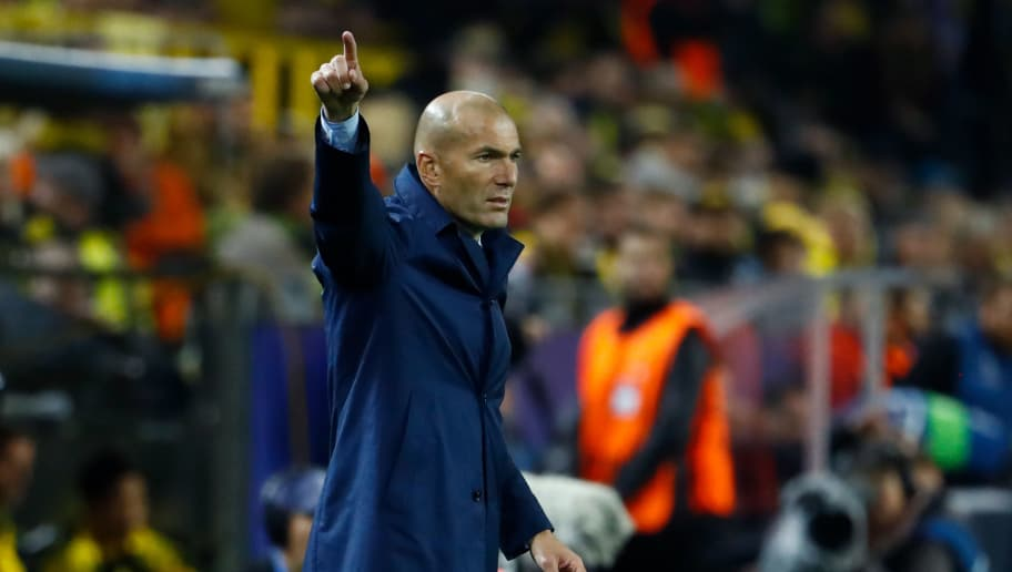 Real Madrid's coach from France Zinedine Zidane react on the sidelines during the UEFA Champions League Group H football match BVB Borussia Dortmund v Real Madrid in Dortmund, western Germany on September 26, 2017. / AFP PHOTO / Odd ANDERSEN        (Photo credit should read ODD ANDERSEN/AFP/Getty Images)