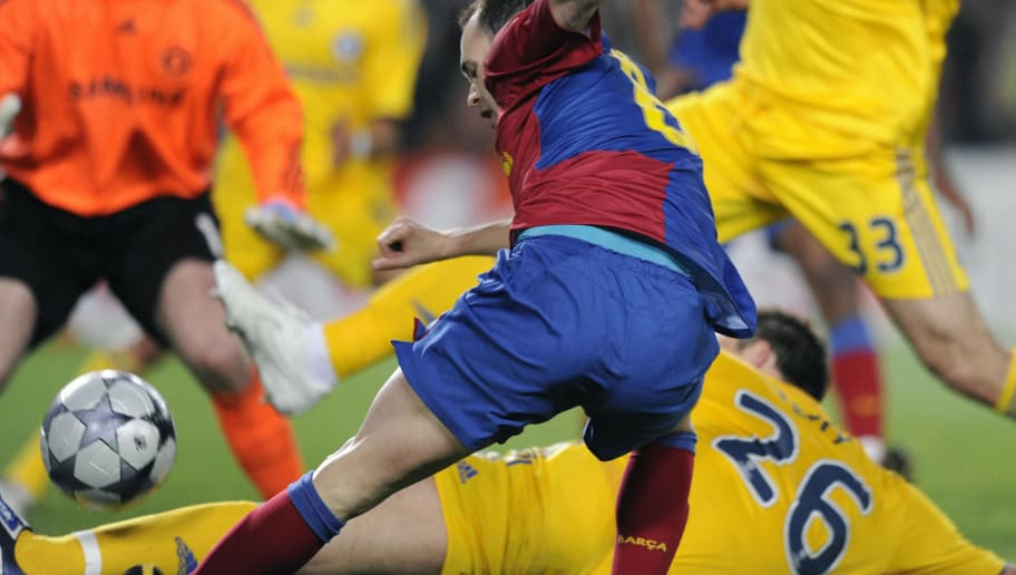 Barcelona�s Spanish midfielder Andrés Iniesta (front) vies with Chelsea´s defender John Terry (down) during their Champions League semi-final, first-leg match at the Camp Nou stadium in Barcelona on April 28, 2009. The match ended in a 0-0 draw. AFP PHOTO/LLUIS GENE. (Photo credit should read LLUIS GENE/AFP/Getty Images)