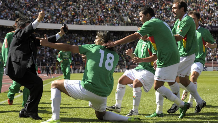 Bolivian forward Marcelo Martins (18) celebrates with his teammates after scoring against Argentina during their FIFA World Cup South Africa-2010 qualifier football match at Hernando Siles stadium in La Paz on April 01, 2009. AFP PHOTO / Juan MABROMATA (Photo credit should read JUAN MABROMATA/AFP/Getty Images)