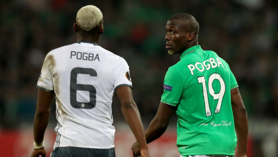 SAINT-ETIENNE, FRANCE - FEBRUARY 22: Florentin Pogba of Saint-Etienne walks on the pitch next to his brother Paul Pogba of Manchester United during the UEFA Europa League Round of 32 second leg match between AS Saint-Etienne and Manchester United at Stade Geoffroy-Guichard on February 22, 2017 in Saint-Etienne, France. (Photo by Christopher Lee/Getty Images)