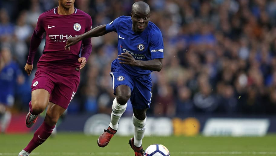 Chelsea's French midfielder N'Golo Kante (R) vies with Manchester City's German midfielder Leroy Sane (L) during the English Premier League football match between Chelsea and Manchester City at Stamford Bridge in London on September 30, 2017. / AFP PHOTO / Adrian DENNIS / RESTRICTED TO EDITORIAL USE. No use with unauthorized audio, video, data, fixture lists, club/league logos or 'live' services. Online in-match use limited to 75 images, no video emulation. No use in betting, games or single club/league/player publications.  /         (Photo credit should read ADRIAN DENNIS/AFP/Getty Images)