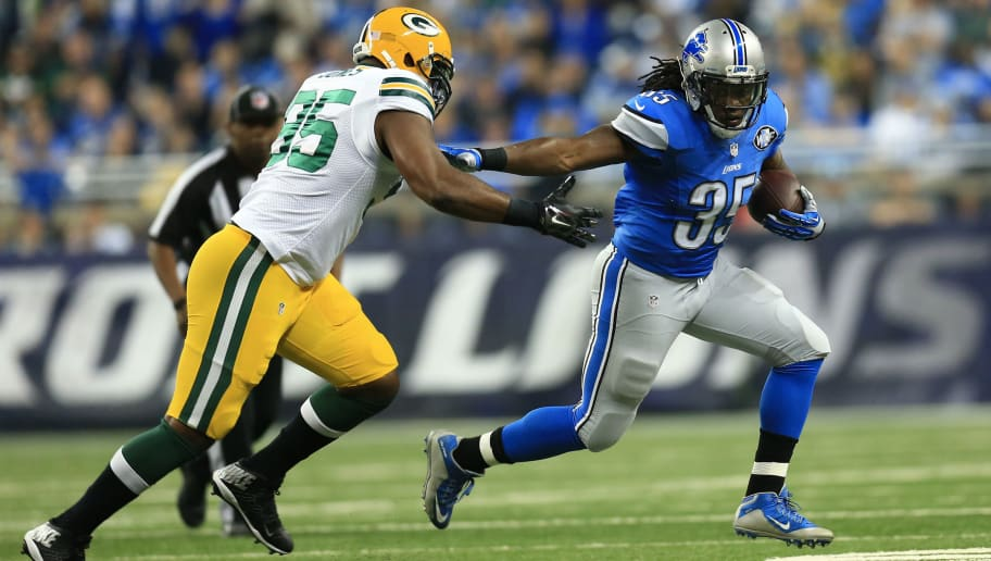 DETROIT, MI - DECEMBER 3: Running back Joique Bell #35 of the Detroit Lions tries to avoid the tackle by defensive end Datone Jones #95 of the Green Bay Packers during the first quarter at Ford Field on December 3, 2015 in Detroit, Michigan. (Photo by Andrew Weber/Getty Images)