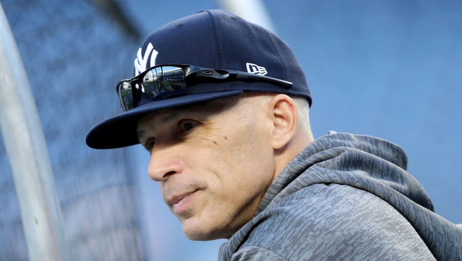 NEW YORK, NY - OCTOBER 03:  Joe Girardi #28 of the New York Yankees looks on during batting practice prior to the American League Wild Card Game against the Minnesota Twins at Yankee Stadium on October 3, 2017 in the Bronx borough of New York City.  (Photo by Abbie Parr/Getty Images)