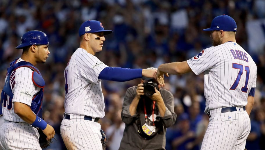 CHICAGO, IL - OCTOBER 09:  Willson Contreras #40, Anthony Rizzo #44, and Wade Davis #71 of the Chicago Cubs celebrate after beating the Washington Nationals 2-1 in game three of the National League Division Series at Wrigley Field on October 9, 2017 in Chicago, Illinois. (Photo by Jonathan Daniel/Getty Images)