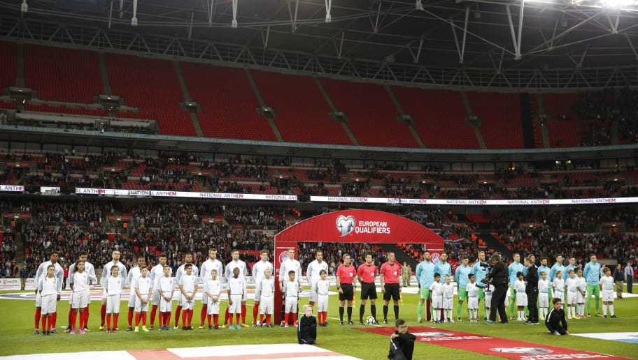 The England and Slovenia teams line up for the national anthems with an empty upper tier in the stands during the FIFA World Cup 2018 qualification football match between England and Slovenia at Wembley Stadium in London on October 5, 2017.  / AFP PHOTO / ADRIAN DENNIS / NOT FOR MARKETING OR ADVERTISING USE / RESTRICTED TO EDITORIAL USE        (Photo credit should read ADRIAN DENNIS/AFP/Getty Images)