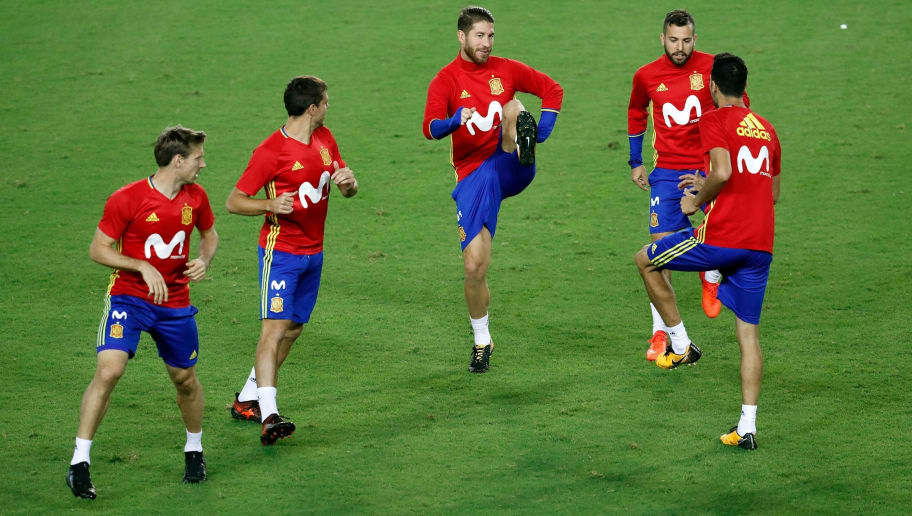 Spain's defender Sergio Ramos (C) trains with his national football team players during a training session at the Teddy stadium in Jerusalem on October 8, 2017, a day ahead of the team's FIFA World Cup 2018 qualifying football match against Israel.  / AFP PHOTO / THOMAS COEX        (Photo credit should read THOMAS COEX/AFP/Getty Images)