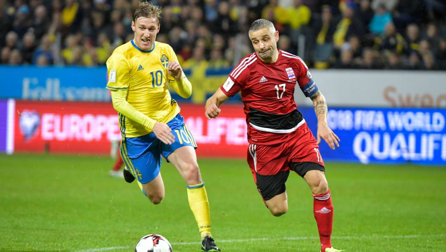 Sweden's midfielder Emil Forsberg (L) vies for the ball with Luxembourg's captain Mario Mutsch during the FIFA World Cup 2018 qualifying match between Sweden and Luxembourg in Solna, north of the capital Stockholm on October 7, 2017. / AFP PHOTO / TT NEWS AGENCY AND TT News Agency / Jessica GOW / Sweden OUT        (Photo credit should read JESSICA GOW/AFP/Getty Images)