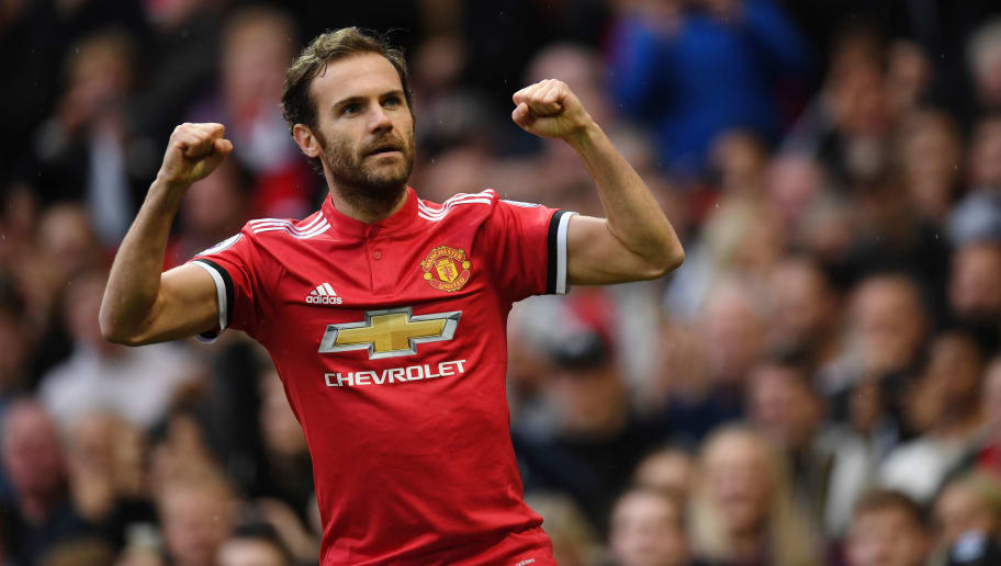 Manchester United's Spanish midfielder Juan Mata celebrates scoring the team's first goal during the English Premier League football match between Manchester United and Crystal Palace at Old Trafford in Manchester, north west England, on September 30, 2017. / AFP PHOTO / Paul ELLIS / RESTRICTED TO EDITORIAL USE. No use with unauthorized audio, video, data, fixture lists, club/league logos or 'live' services. Online in-match use limited to 75 images, no video emulation. No use in betting, games or single club/league/player publications.  /         (Photo credit should read PAUL ELLIS/AFP/Getty Images)