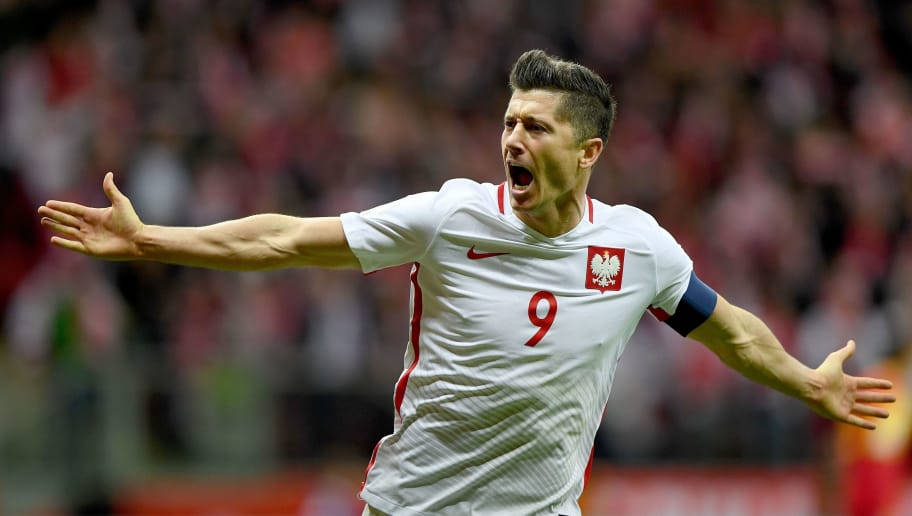 Poland's forward Robert Lewandowski reacts after he scored a goal during the FIFA World Cup 2018 qualification football match between Poland and Montenegro in Warsaw on October 8, 2017. / AFP PHOTO / JANEK SKARZYNSKI        (Photo credit should read JANEK SKARZYNSKI/AFP/Getty Images)