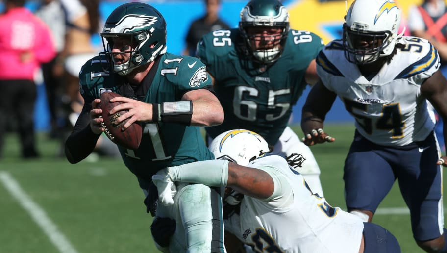 CARSON, CA - OCTOBER 01:  Darius Philon #93 of the Los Angeles Chargers sacks Carson Wentz #11 of the Philadelphia Eagles during the NFL game at StubHub Center on October 1, 2017 in Carson, California.  (Photo by Stephen Dunn/Getty Images)
