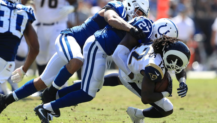 LOS ANGELES, CA - SEPTEMBER 10:   Antonio Morrison #44 and  Nate Hairston #27 of the Indianapolis Colts tackle  Sammy Watkins #12 of the Los Angeles Rams during the first half of a game  at Los Angeles Memorial Coliseum on September 10, 2017 in Los Angeles, California.  (Photo by Sean M. Haffey/Getty Images)
