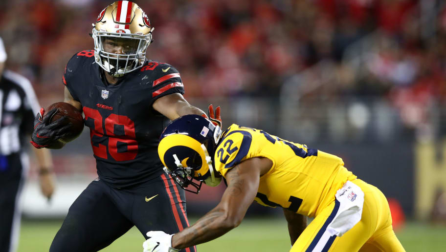 SANTA CLARA, CA - SEPTEMBER 21:  Carlos Hyde #28 of the San Francisco 49ers rushes against the Los Angeles Rams during their NFL game at Levi's Stadium on September 21, 2017 in Santa Clara, California.  (Photo by Ezra Shaw/Getty Images)