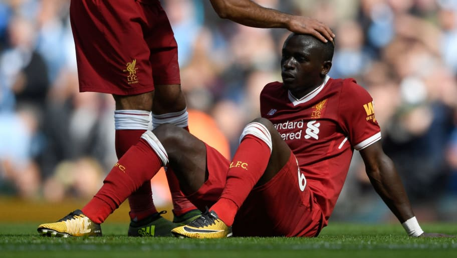 MANCHESTER, ENGLAND - SEPTEMBER 09:  Mohamed Salah of Liverpool comforts Sadio Mane of Liverpool after he reacts to being sent off during the Premier League match between Manchester City and Liverpool at Etihad Stadium on September 9, 2017 in Manchester, England.  (Photo by Stu Forster/Getty Images)