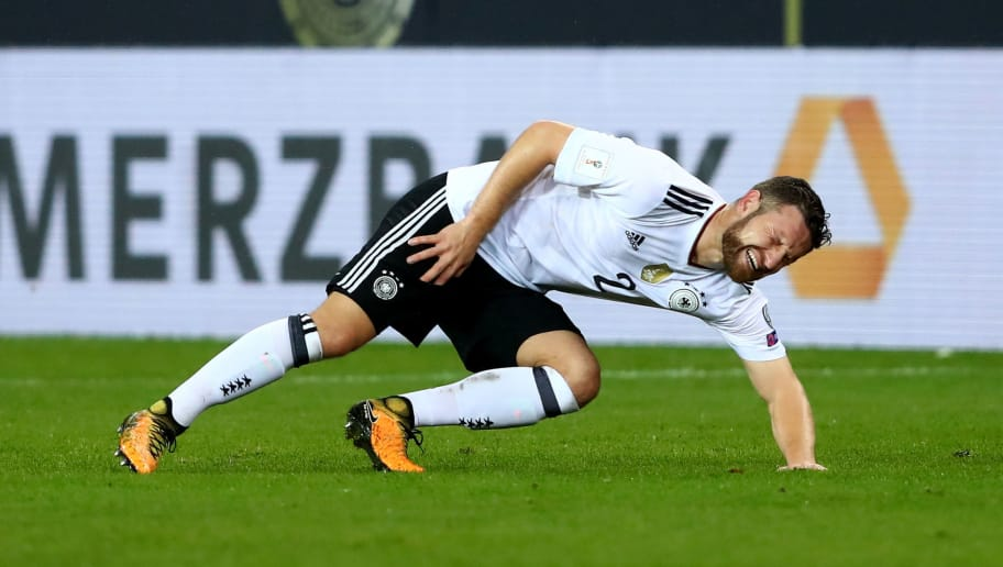 KAISERSLAUTERN, GERMANY - OCTOBER 08:  Shkodran Mustafi of Germany lies injured on the pitch during the FIFA 2018 World Cup Qualifier between Germany and Azerbaijan at Fritz-Walter-Stadion on October 8, 2017 in Kaiserslautern, Rhineland-Palatinate.  (Photo by Alexander Hassenstein/Bongarts/Getty Images)