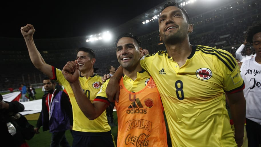 LIMA, PERU - OCTOBER 10: Radamel Falcao of Colombia celebrates with teammates Abel Aguilar and James Rodriguez the qualifying to the World Cup Russia 2018 after the match between Peru and Colombia as part of FIFA 2018 World Cup Qualifiers at National Stadium on October 10, 2017 in Lima, Peru. (Photo by Leonardo Fernandez/Getty Images)