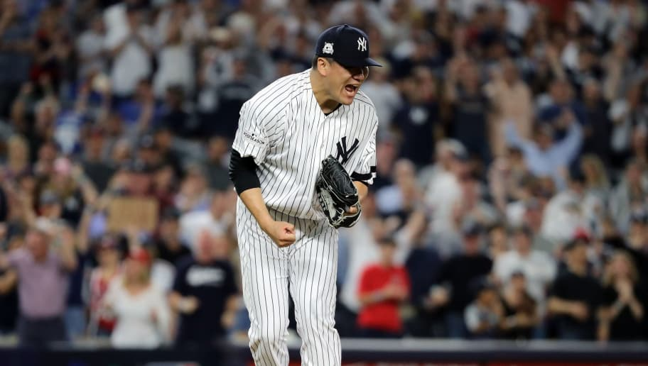 NEW YORK, NY - OCTOBER 08:  Masahiro Tanaka #19 of the New York Yankees reacts after giving up a triple to Jason Kipnis #22 of the Cleveland Indians during the fourth inning of game three of the American League Division Series at Yankee Stadium on October 8, 2017 in New York City.  (Photo by Abbie Parr/Getty Images)