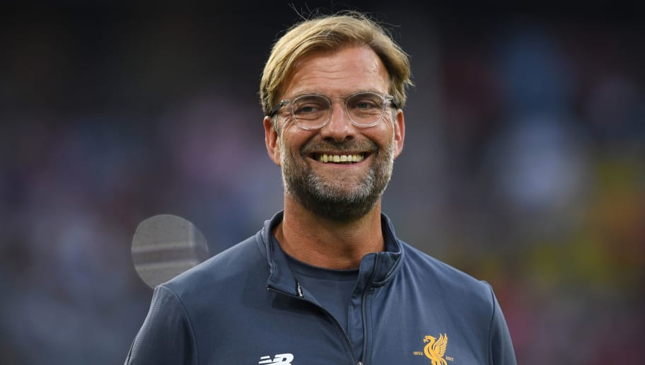 Liverpools German headcoach Juergen Klopp laughs prior the final Audi Cup football match between Atletico Madrid and FC Liverpool in the stadium in Munich, southern Germany, on August 2, 2017.  / AFP PHOTO / Christof STACHE        (Photo credit should read CHRISTOF STACHE/AFP/Getty Images)