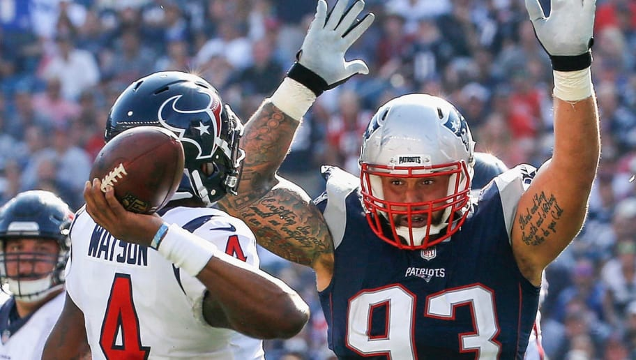 FOXBORO, MA - SEPTEMBER 24:  Lawrence Guy #93 of the New England Patriots defends Deshaun Watson #4 of the Houston Texans during the third quarter of a game at Gillette Stadium on September 24, 2017 in Foxboro, Massachusetts.  (Photo by Jim Rogash/Getty Images)