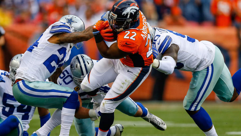 DENVER, CO - SEPTEMBER 17:  Running back C.J. Anderson #22 of the Denver Broncos escapes from a group of Dallas Cowboys defenders in the first half of a game at Sports Authority Field at Mile High on September 17, 2017 in Denver, Colorado. (Photo by Justin Edmonds/Getty Images)