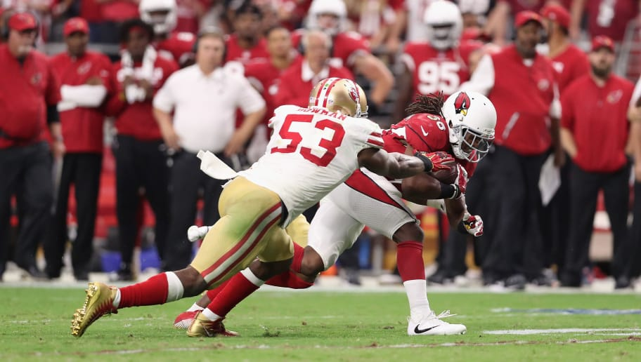 GLENDALE, AZ - OCTOBER 01: Middle linebacker NaVorro Bowman #53 of the San Francisco 49ers tackles running back Andre Ellington #38 of the Arizona Cardinals during overtime of the NFL game at the University of Phoenix Stadium on October 1, 2017 in Glendale, Arizona. Arizona won 18-15. (Photo by Christian Petersen/Getty Images)
