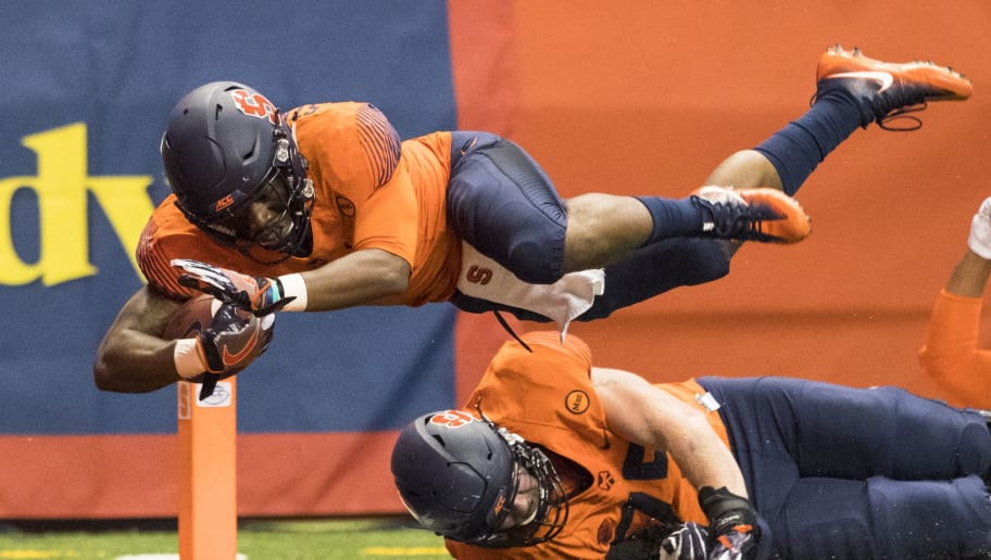 SYRACUSE, NY - OCTOBER 13:  Dontae Strickland #4 of the Syracuse Orange dives into the end zone for a touchdown during the first quarter against the Clemson Tigers at the Carrier Dome on October 13, 2017 in Syracuse, New York.  (Photo by Brett Carlsen/Getty Images)