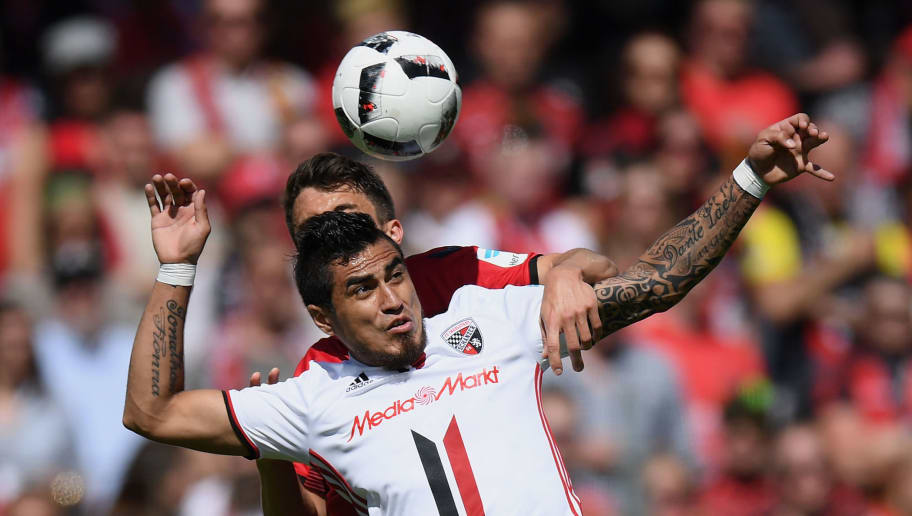 FREIBURG IM BREISGAU, GERMANY - MAY 13: Dario Lezcano of Ingolstadt jumps for a header with Marc-Oliver Kempf of Freiburg during the Bundesliga match between SC Freiburg and FC Ingolstadt 04 at Schwarzwald-Stadion on May 13, 2017 in Freiburg im Breisgau, Germany.  (Photo by Matthias Hangst/Bongarts/Getty Images)