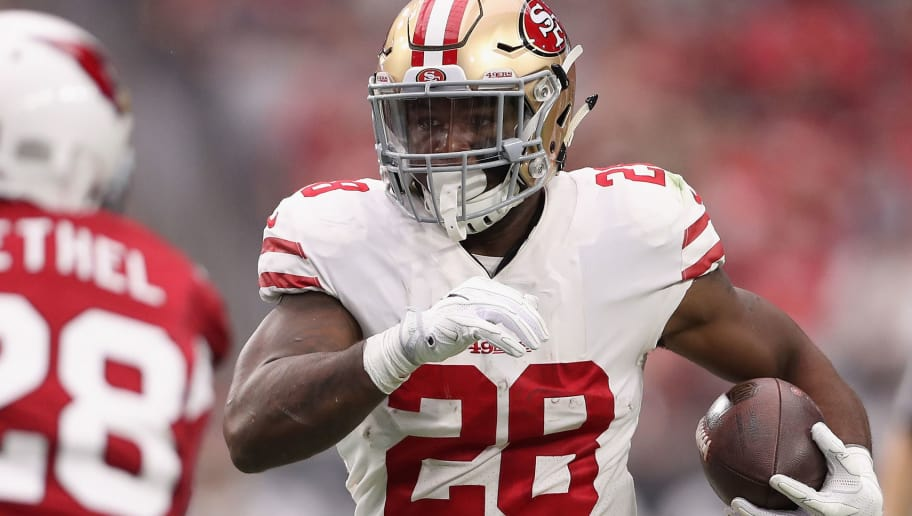 GLENDALE, AZ - OCTOBER 01:  Running back Carlos Hyde #28 of the San Francisco 49ers rushes the football against the Arizona Cardinals during the NFL game at the University of Phoenix Stadium on October 1, 2017 in Glendale, Arizona. The Cardinals defeated the 49ers in overtime 18-15.  (Photo by Christian Petersen/Getty Images)