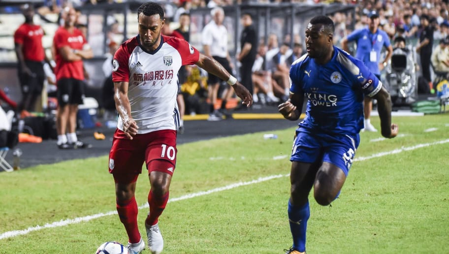 Leicester City's Jamaican defender Wes Morgan challenges West Bromwich Albion's Scottish midfielder Matt Phillips (L) during the 2017 Premier League Asia Trophy football match between Leicester City and West Bromwich Albion at the Hong Kong Stadium in Hong Kong on July 19, 2017. / AFP PHOTO / ISAAC LAWRENCE        (Photo credit should read ISAAC LAWRENCE/AFP/Getty Images)