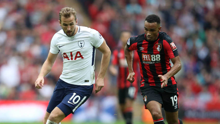 LONDON, ENGLAND - OCTOBER 14:  Junior Stanislas of Bournemouth battles with Harry Kane of Spurs during the Premier League match between Tottenham Hotspur and AFC Bournemouth at Wembley Stadium on October 14, 2017 in London, England.  (Photo by Julian Finney/Getty Images)