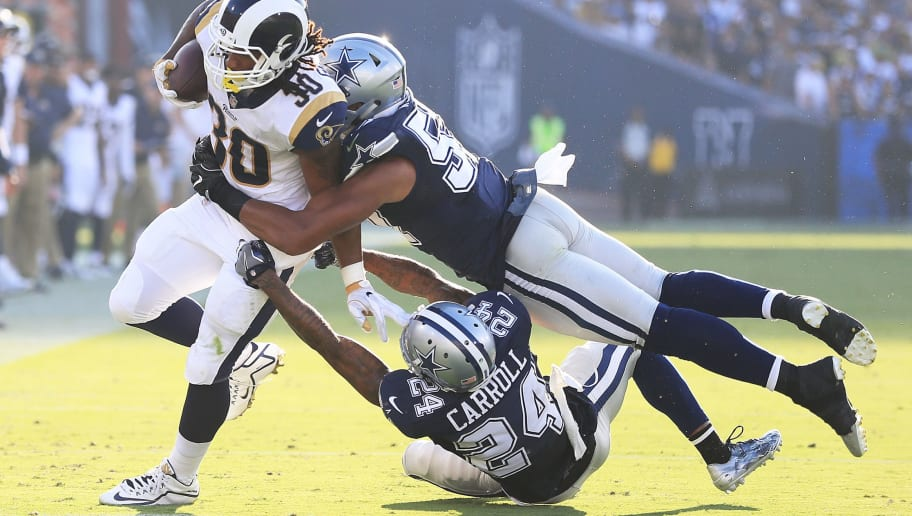 LOS ANGELES, CA - AUGUST 12:  Todd Gurley #30 of the Los Angeles Rams gets tackled by Damien Wilson #57 and Nolan Carroll #24 of the Dallas Cowboys during the preseason game against the Dallas Cowboys at the Los Angeles Memorial Coliseum on August 12, 2017 in Los Angeles, California.  (Photo by Sean M. Haffey/Getty Images)