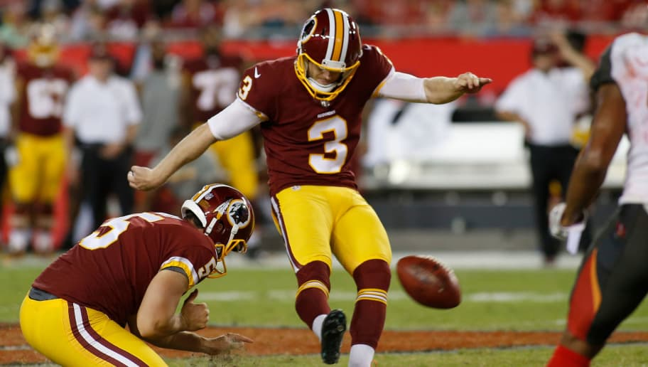 TAMPA, FL - AUGUST 31:  Kicker Dustin Hopkins #3 of the Washington Redskins kicks 50 yard field goal while getting a hold from punter Tress Way #5 during the fourth quarter of an NFL preseason football game on August 31, 2017 at Raymond James Stadium in Tampa, Florida. (Photo by Brian Blanco/Getty Images)