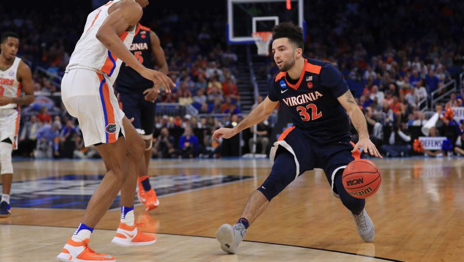 ORLANDO, FL - MARCH 18:  London Perrantes #32 of the Virginia Cavaliers drives against Devin Robinson #1 of the Florida Gators in the second half during the second round of the 2017 NCAA Men's Basketball Tournament at the Amway Center on March 18, 2017 in Orlando, Florida.  The Florida Gators won 65-39. (Photo by Mike Ehrmann/Getty Images)