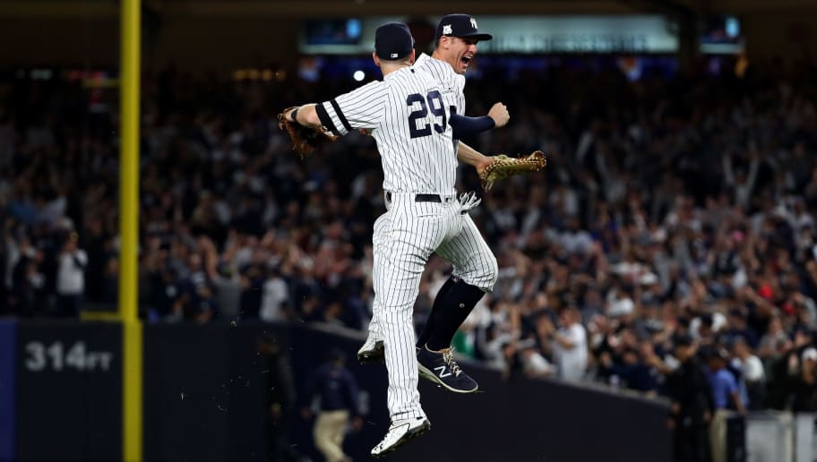NEW YORK, NY - OCTOBER 18: Todd Frazier #29 and Greg Bird #33 of the New York Yankees celebrate after defeating the Houston Astros in Game Five of the American League Championship Series at Yankee Stadium on October 18, 2017 in the Bronx borough of New York City. The New York Yankees defeated the Houston Astros 5-0. (Photo by Al Bello/Getty Images)