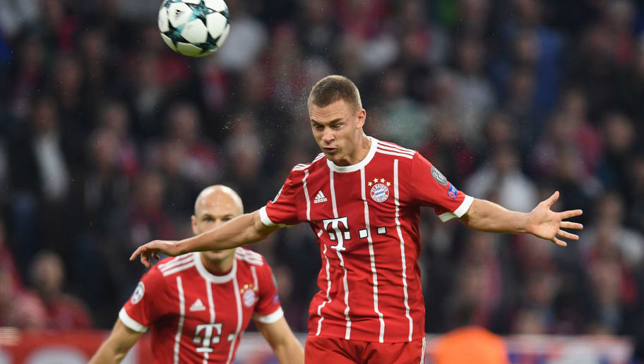 Bayern Munich's midfielder Joshua Kimmich heads the second goal during the Champions League group B match between FC Bayern Munich and Celtic Glasgow in Munich, southern Germany, on October 18, 2017. / AFP PHOTO / Christof STACHE        (Photo credit should read CHRISTOF STACHE/AFP/Getty Images)
