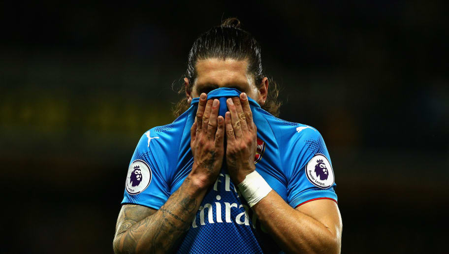 WATFORD, ENGLAND - OCTOBER 14:  Hector Bellerin of Arsenal reacts during the Premier League match between Watford and Arsenal at Vicarage Road on October 14, 2017 in Watford, England.  (Photo by Charlie Crowhurst/Getty Images)