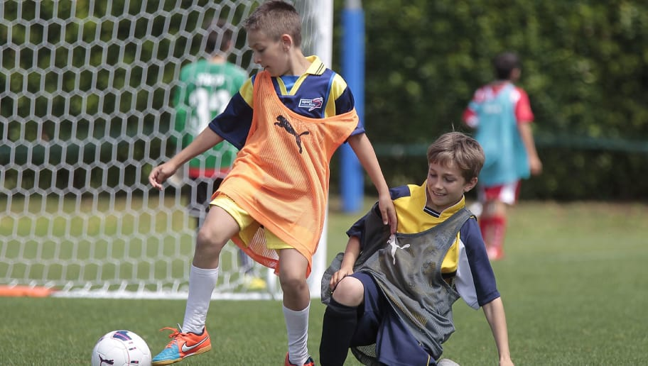 FLORENCE, ITALY - JUNE 21: A phase of football 5 : 5 during the Italian Football Federation Grassroots Festival at Coverciano on June 21, 2015 in Florence, Italy.  (Photo by Gabriele Maltinti/Getty Images)