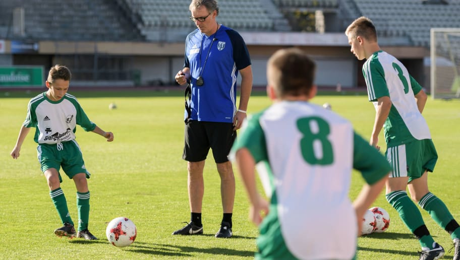 French football coach Laurent Blanc attends a training session with young football players from the Canton of Vaud as part of an invitation by the football association 'Passion Foot' on October 18, 2017 in Lausanne. / AFP PHOTO / Fabrice COFFRINI        (Photo credit should read FABRICE COFFRINI/AFP/Getty Images)