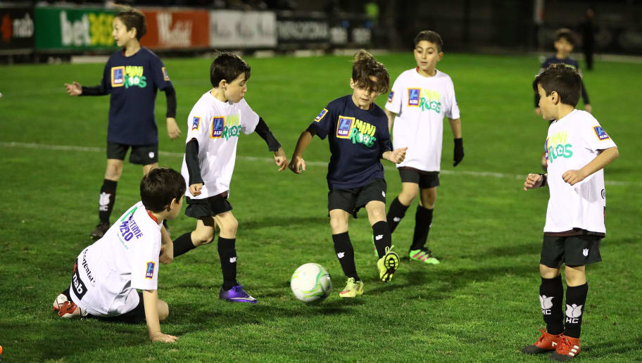 MELBOURNE, AUSTRALIA - AUGUST 09:  Children play soccer at the half time break during the FFA Cup round of 32 match between Hume City FC and Bentleigh Greens at John Iilhan Memorial Reserve on August 9, 2017 in Melbourne, Australia.  (Photo by Robert Cianflone/Getty Images)