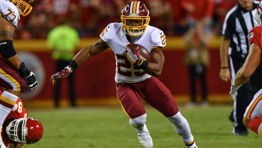 KANSAS CITY, MO - OCTOBER 2: Running back Chris Thompson #25 of the Washington Redskins hits the whole in the fourth quarter of the game against the Kansas City Chiefs at Arrowhead Stadium on October 2, 2017 in Kansas City, Missouri. (Photo by Peter Aiken/Getty Images)
