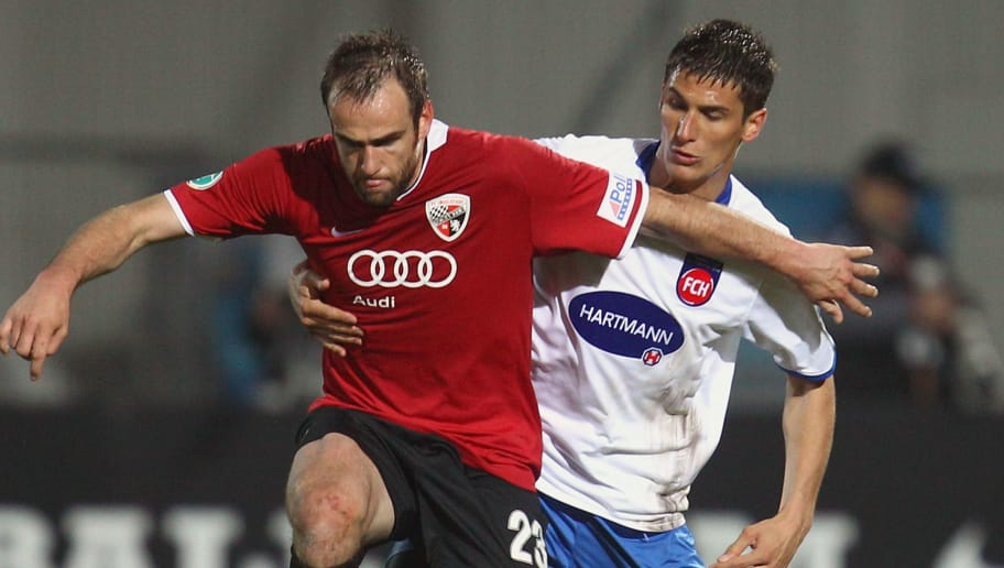INGOLSTADT, GERMANY - APRIL 14:  Steffen Wohlfarth (L) of Ingolstadt battles for the ball with Florian Krebs of Heidenheim during the 3.Liga match between FC Ingolstadt and 1. FC Heidenheim at the Tuja-Stadium on April 14, 2010 in Ingolstadt, Germany.  (Photo by Alexander Hassenstein/Bongarts/Getty Images)